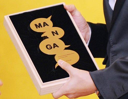 Золотая статуэтка Международной премии манга